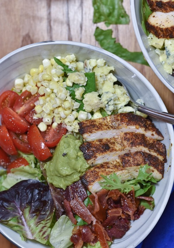 Cobb salad in a bowl with a fork.