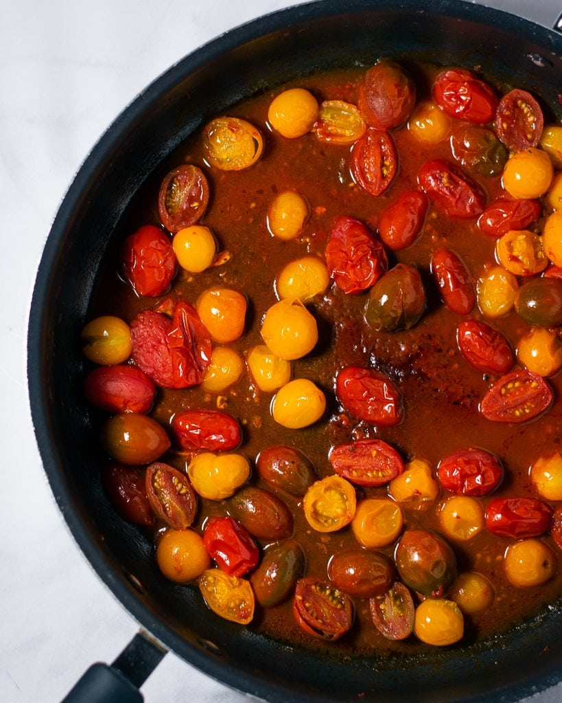 Cherry tomato sauce in a black skillet