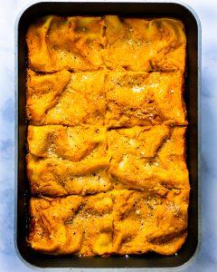 Overhead shot of pumpkin spinach lasagna in a casserole dish.