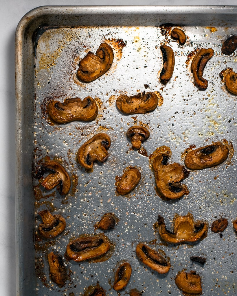 A sheet pan of roasted mushrooms.