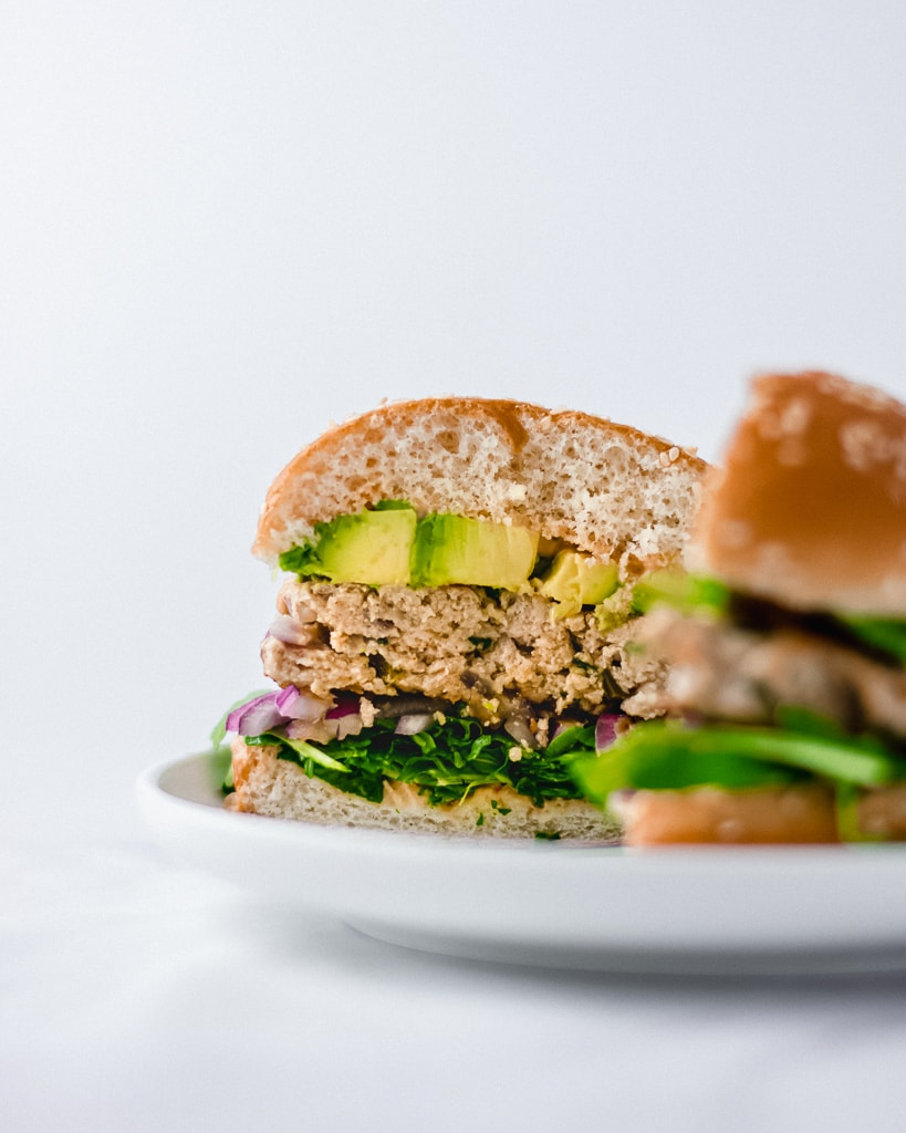 Head-on view of a Jalapeño Chicken Burger cut in half.