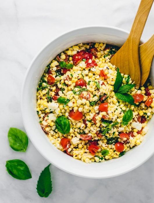 Overhead view of Corn Salad with Tomatoes, Feta, and Herbs
