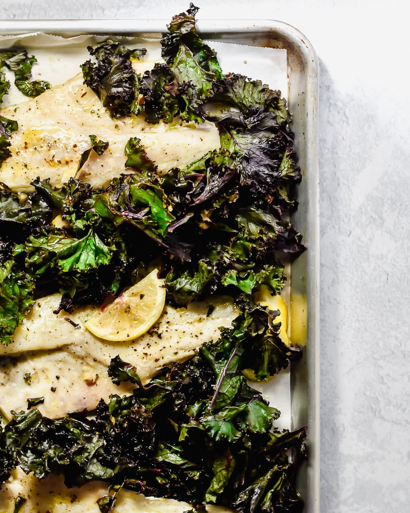 White fish on a sheet pan with kale and lemon