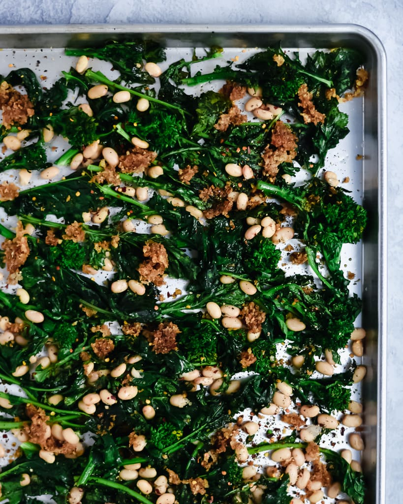broccoli rabe, white beans, and cheddar breadcrumbs on a sheet pan