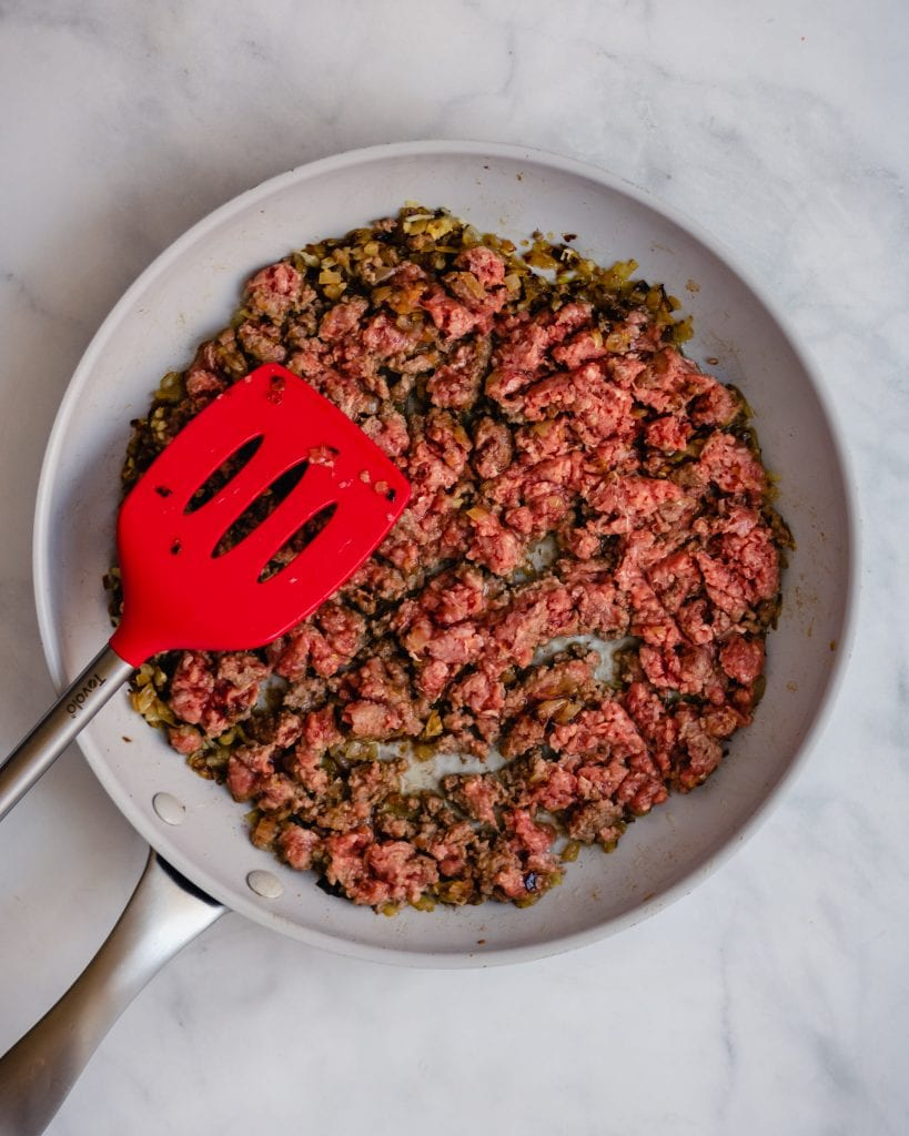 uncooked ground beef on a skillet