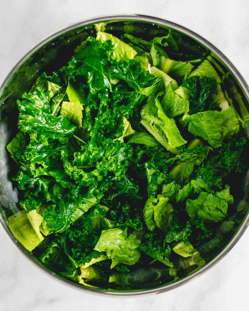 kale and romaine in a silver bowl