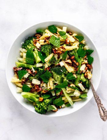 broccoli pasta salad in a white bowl