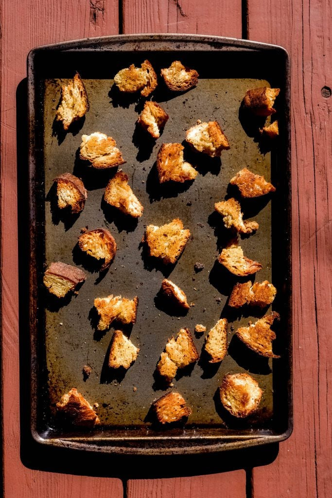 baked croutons on a sheet pan